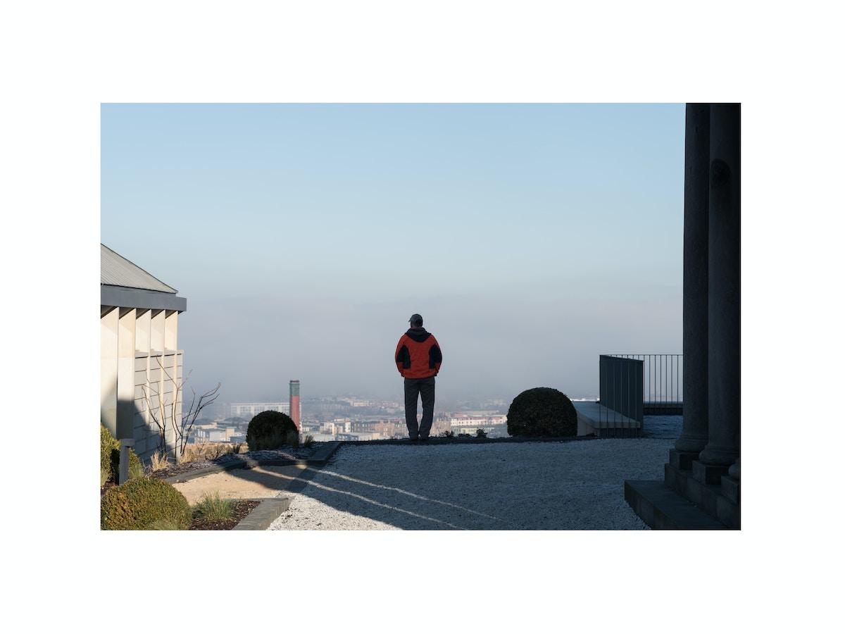 A man stands admiring the Edinburgh skyline.