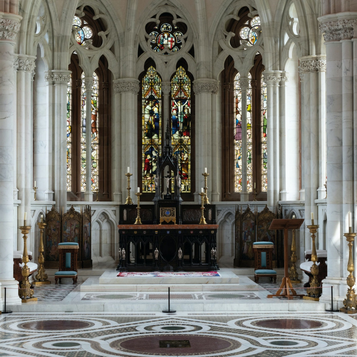 Interior shot of church with stained glass windows.