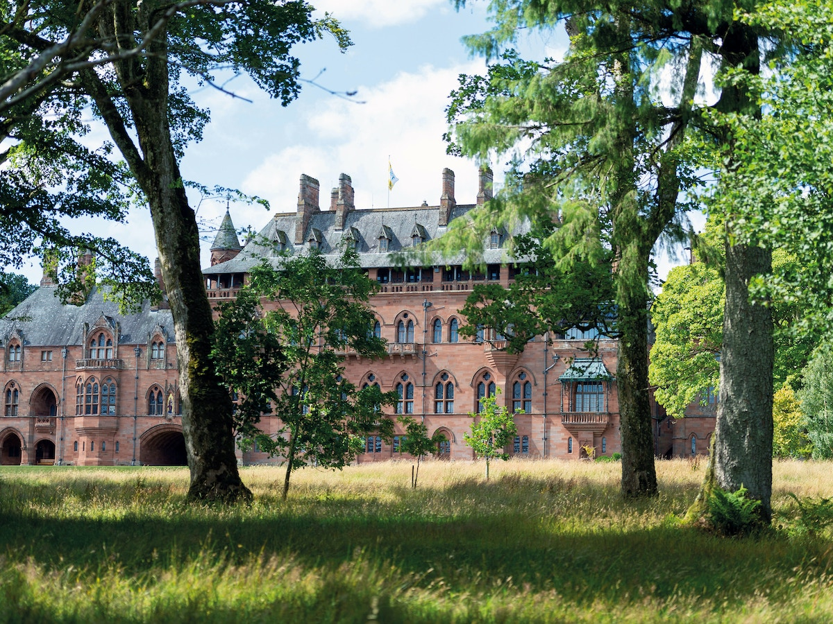 Mount Stuart house appearing behind trees.