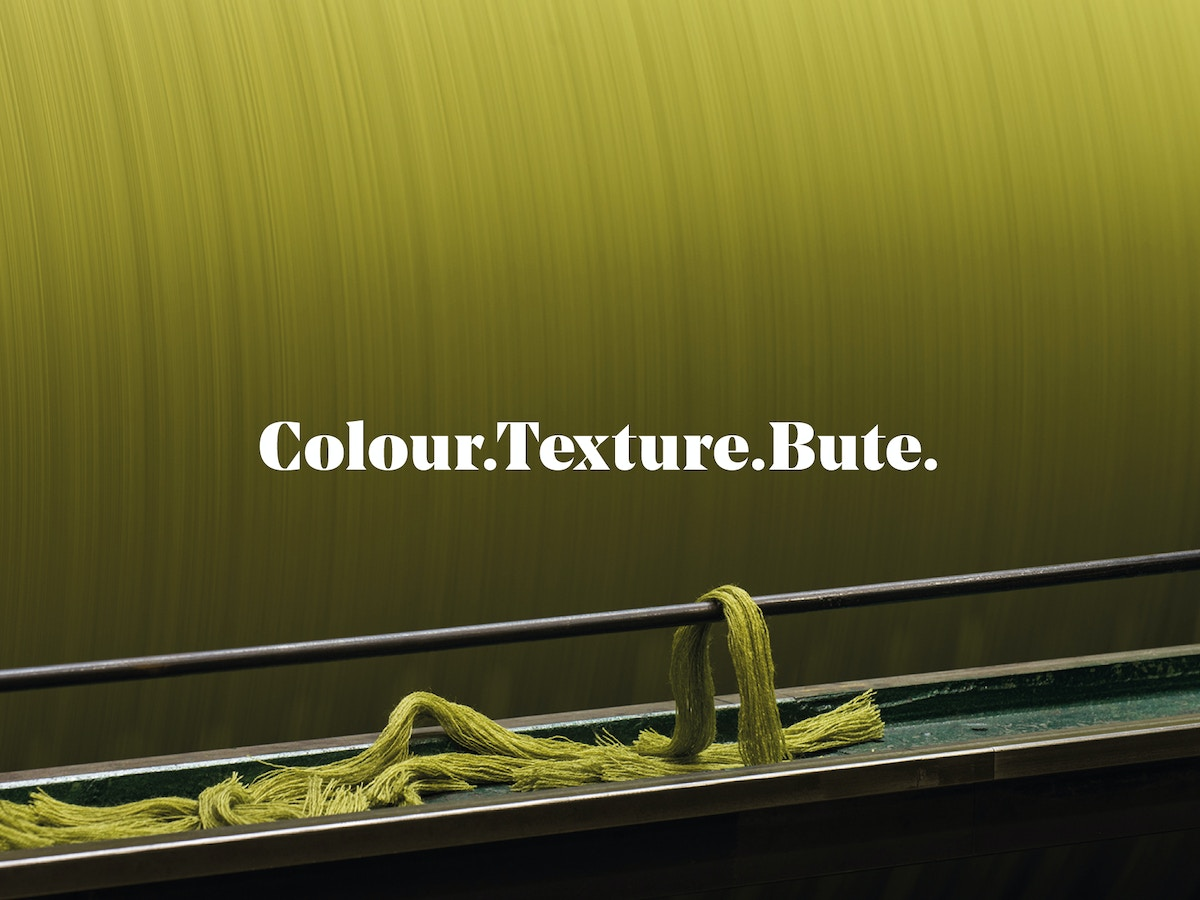 "A strap-line that reads ""Colour.Texture.Bute"" on a yellow background."