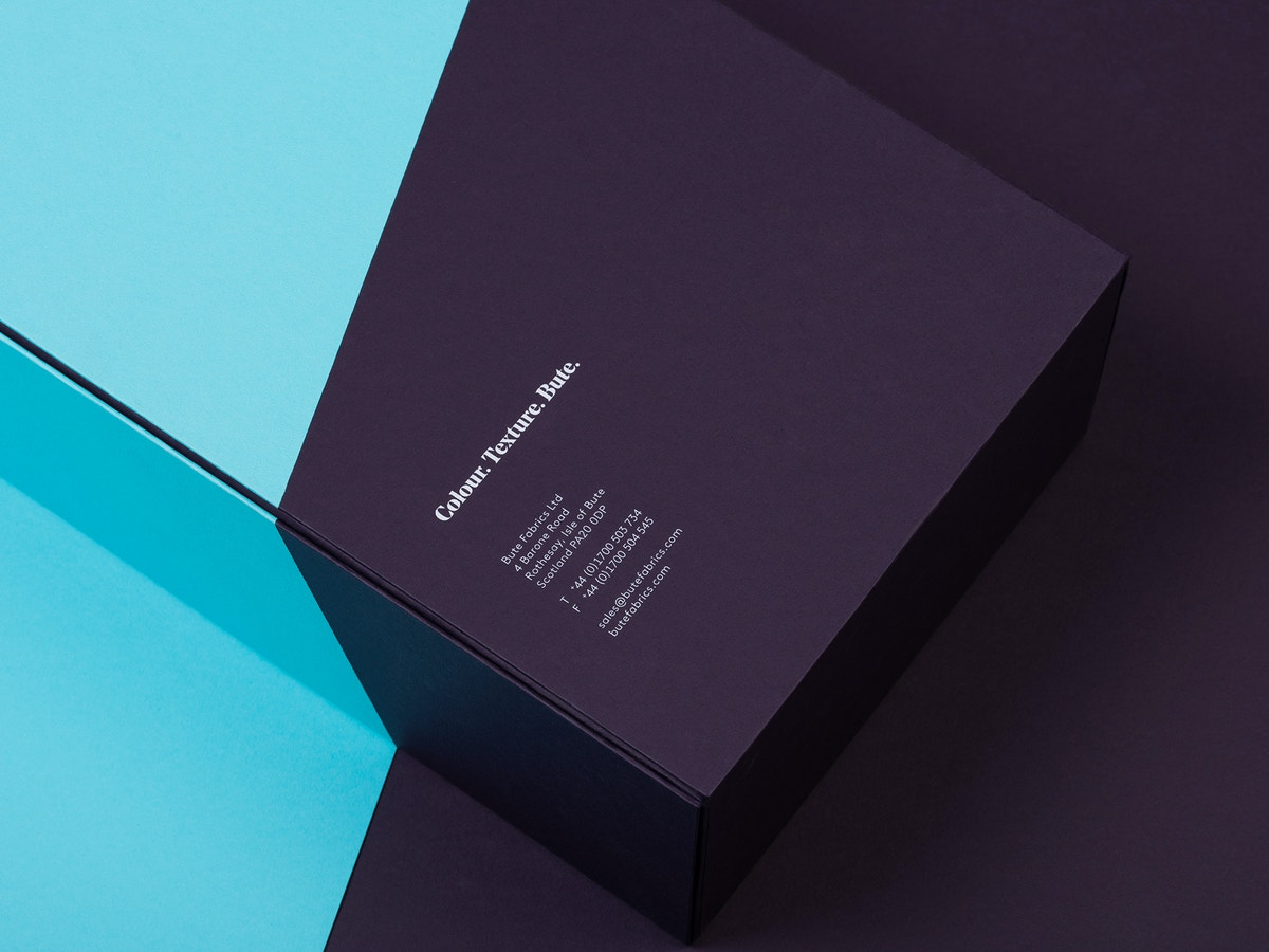 "Detail of back of sample box. There is text that reads ""Colour, Texture, Bute""."