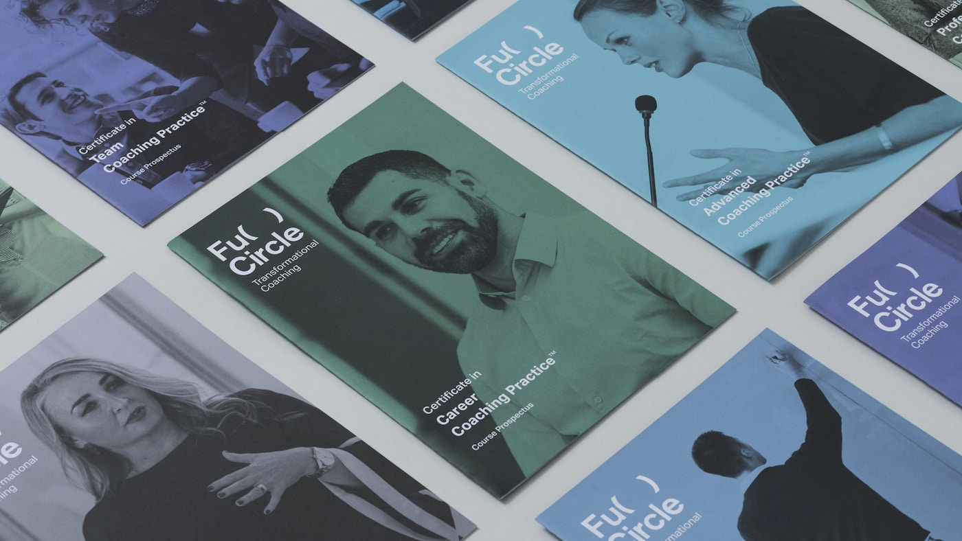 A range of print brochures in different colours. There is the Full Circle logo on the front of the brochures.