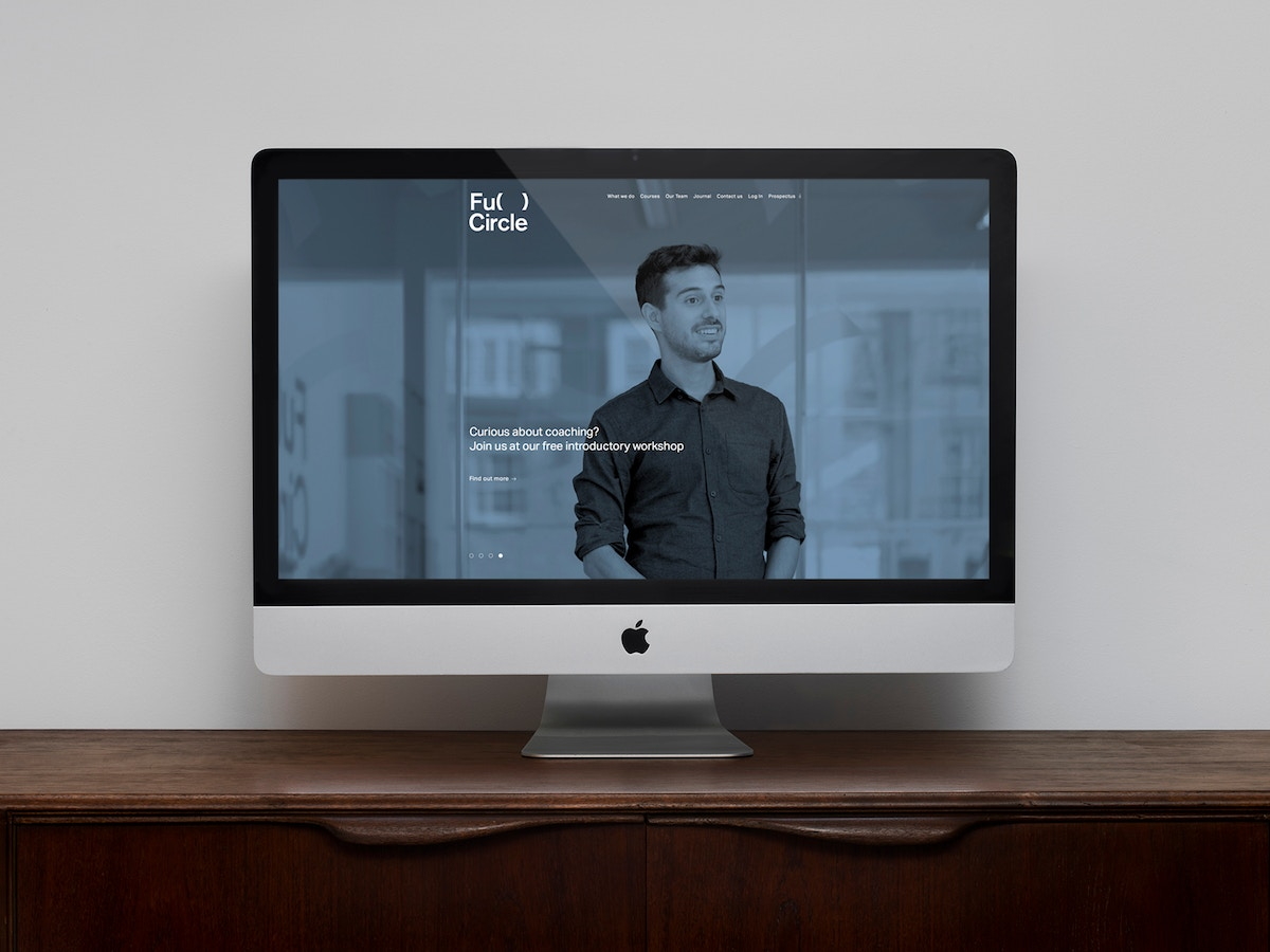 The Full Circle website shown on an iMac screen.