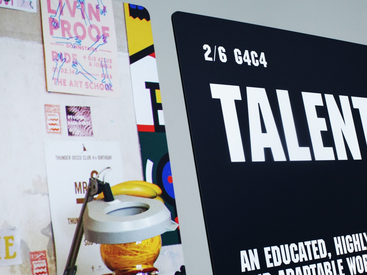 """Detail of exhibition boards. There is text that reads """"Talent"""""""