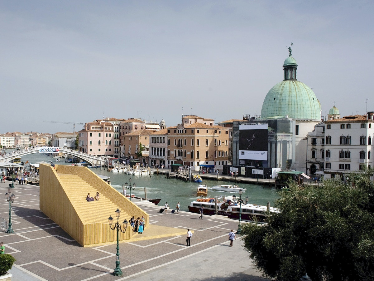 Skyline of Venice. In the foreground there is a wooden structure.