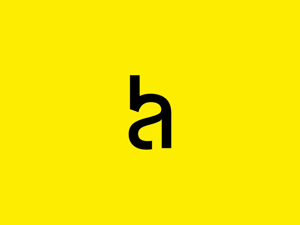 Hoskins Architects logo in black on a yellow background.
