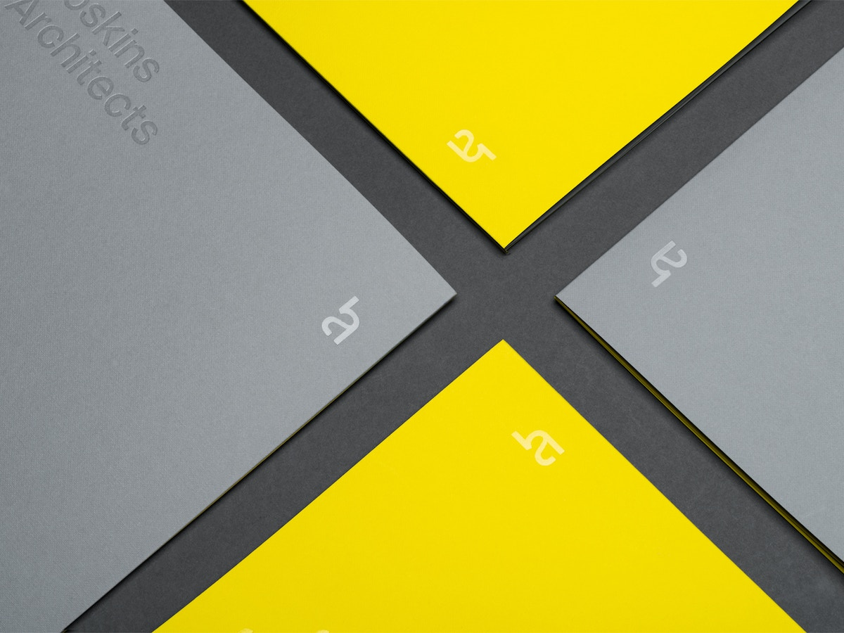 Yellow and grey brochure covers.