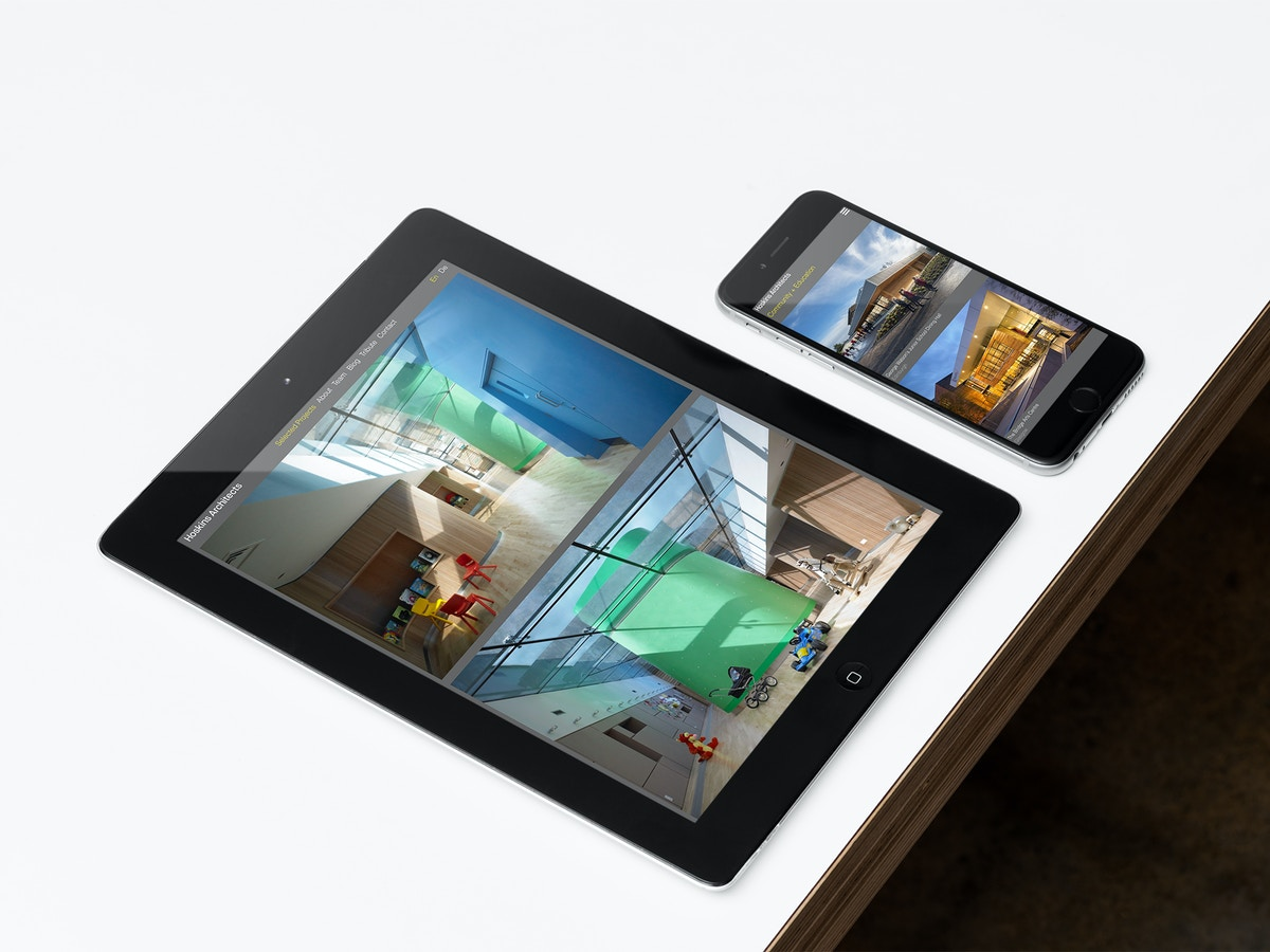 Mock up of website for Hoskins Architects on an iPad and iPhone on a white tabletop.