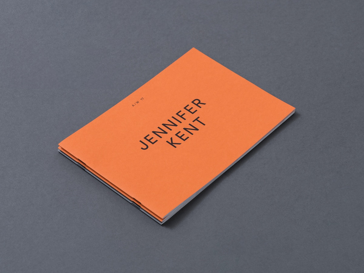 """An orange booklet that has text on the front that reads """"Jennifer Kent""""."""