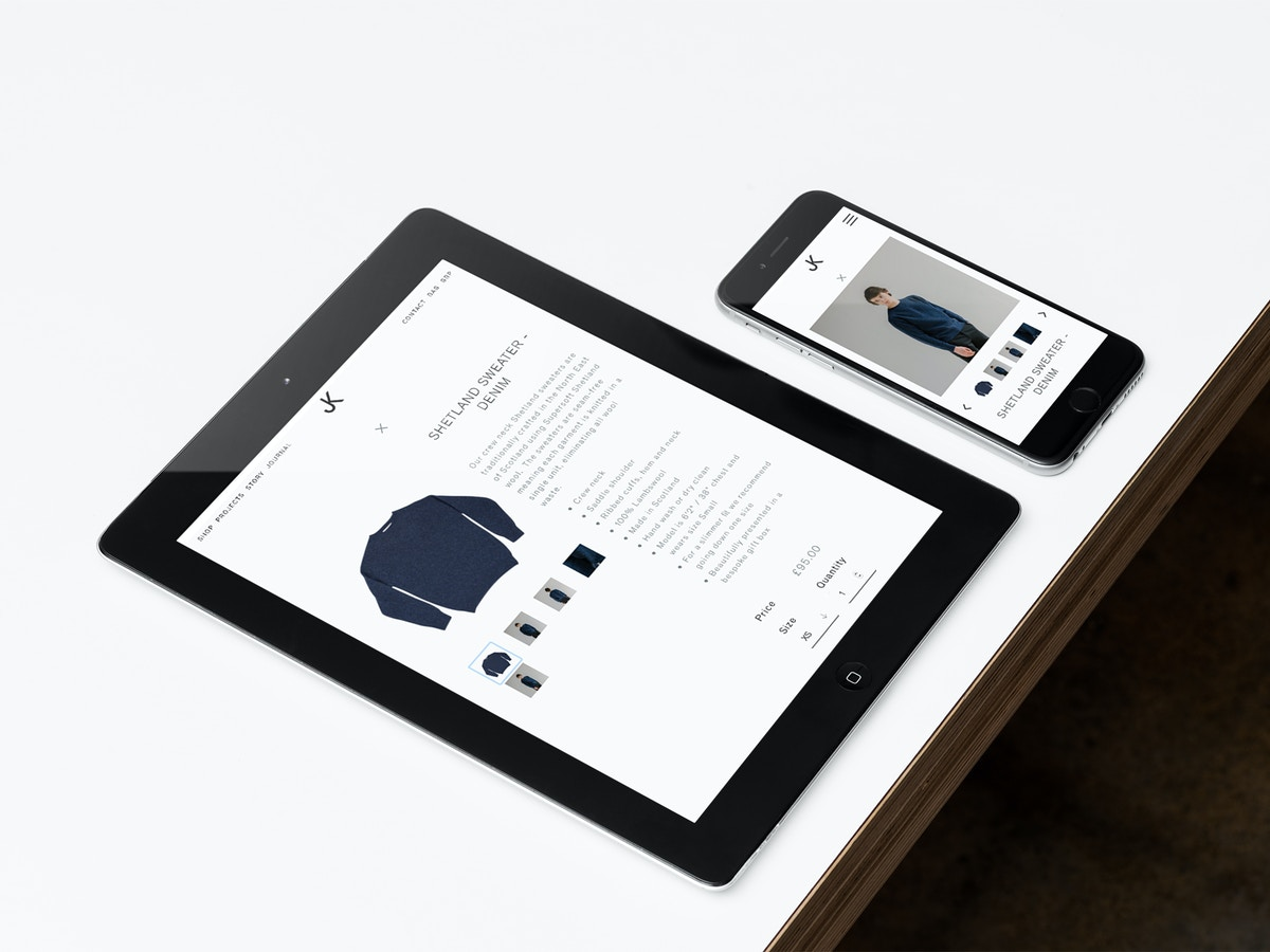 Mock up of the Jennifer Kent website shown on an iPad and iPhone sitting on a white tabletop.