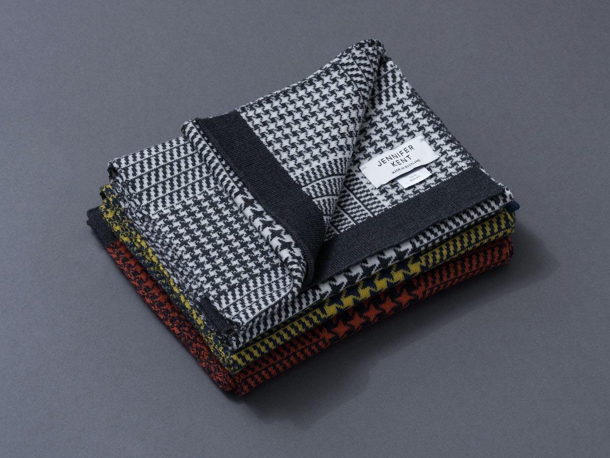 Three scarves sitting on top of each other.