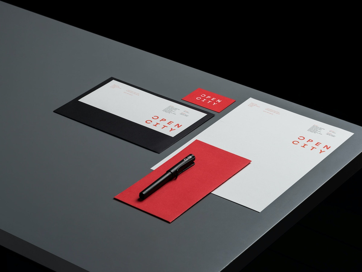 """Stationery for Open City. There is type set in red that reads """"Open City"""" on it."""
