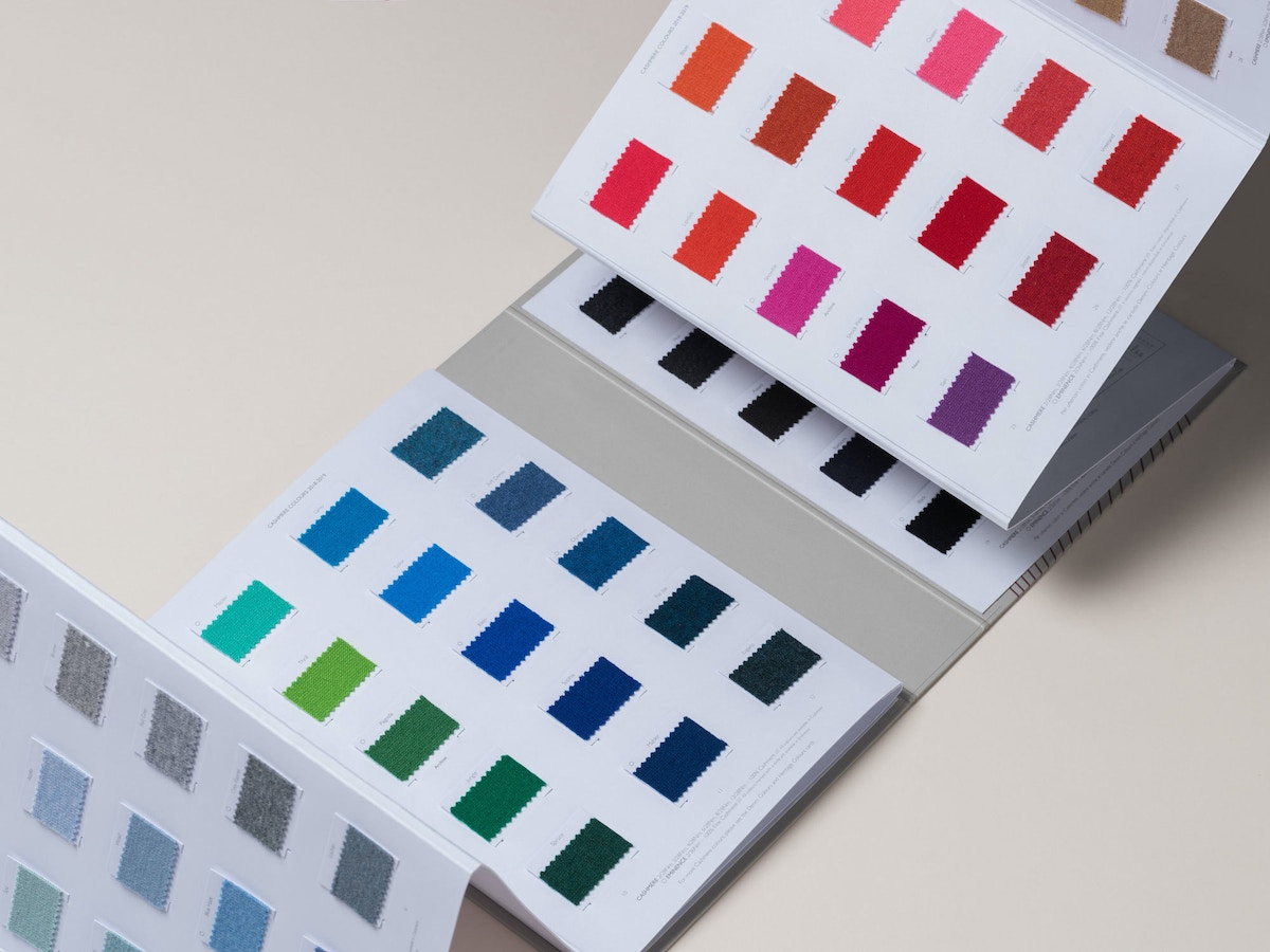 Multicoloured shade cards that have blue, green, red and pink shades on.