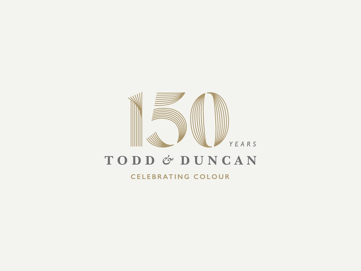 "A logo that reads ""150 years"" ""Todd & Duncan"" ""Celebrating Colour"""